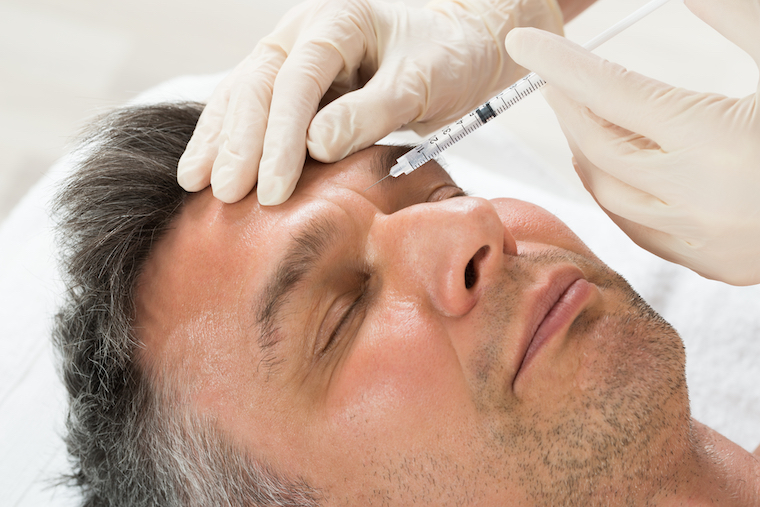 man getting injected with botox